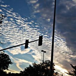 mondaymorningsunrise clouds bluesky trafficlights streetlights